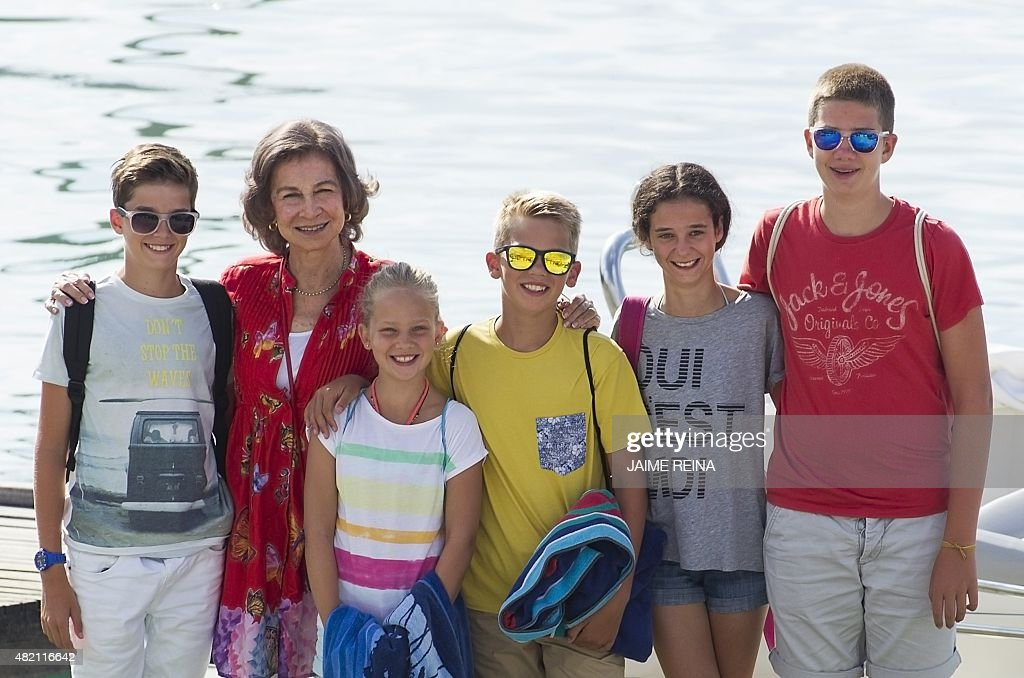 Spain's Queen Sofia (2L) poses with her grandchildren (From L) Pablo Nicolas, Irene, Miguel, Victoria Federica and Juan Valentin on the first day at their sailing school in Palma de Mallorca on July 27, 2015. The Royal Family spend their traditional summer holidays at the Marivent Palace.