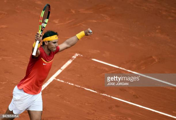 TOPSHOT Spain's Rafa Nadal celebrates winning 62 62 63 the Davis Cup quarterfinal tennis match against Germany's Philipp Kohlschreiber at the...