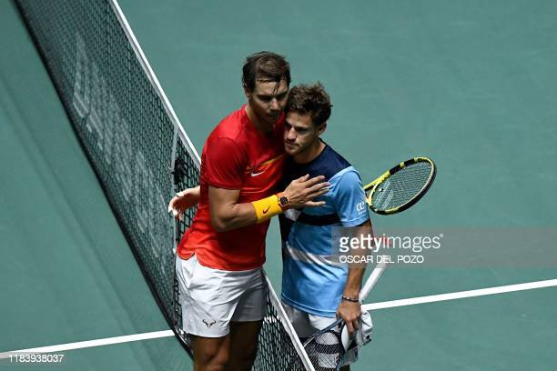 Spain's Rafael Nadal and Argentina's Diego Schwartzman hug at the end of the singles quarter-final tennis match between Argentina and Spain at the...