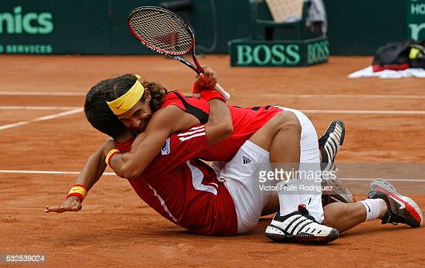Spain's Rafael Nadal and Fernando Verdasco celebrate after winning their Davis Cup play-off doubles tennis match against Italy's Danielle Bracciali...