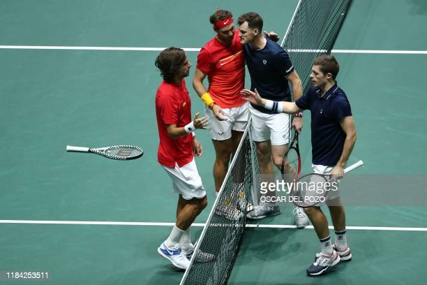 Spain's Rafael Nadal and Spain's Feliciano Lopez are congratulated by Great Britain's Jamie Murray and Great Britain's Neal Skupski after winning the...
