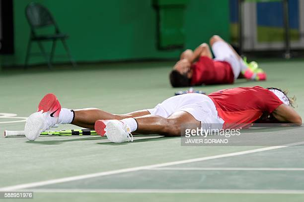 Spain's Rafael Nadal and Spain's Marc Lopez react after winning the men's doubles final tennis match against Romania's Florin Mergea and Romania's...