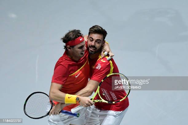 Spain's Rafael Nadal and Spain's Marcel Granollers celebrate after winning the doubles quarter-final tennis match against Argentina's Leonardo Mayer...