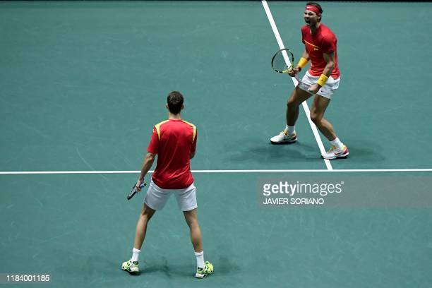 Spain's Rafael Nadal and Spain's Marcel Granollers react during the doubles quarterfinal tennis match against Argentina's Leonardo Mayer and...