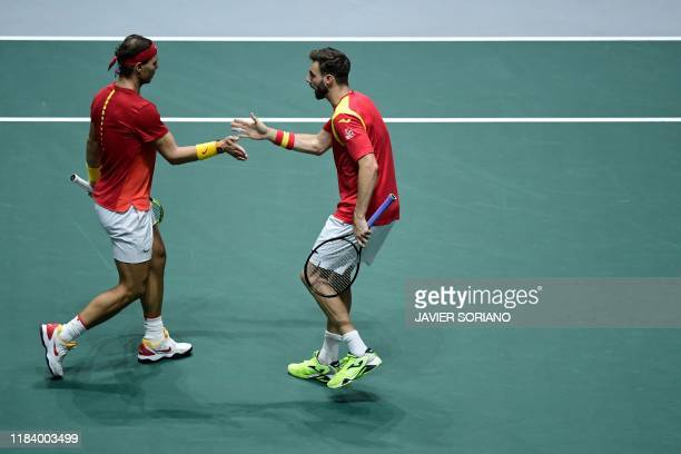 Spain's Rafael Nadal and Spain's Marcel Granollers react during the doubles quarter-final tennis match against Argentina's Leonardo Mayer and...
