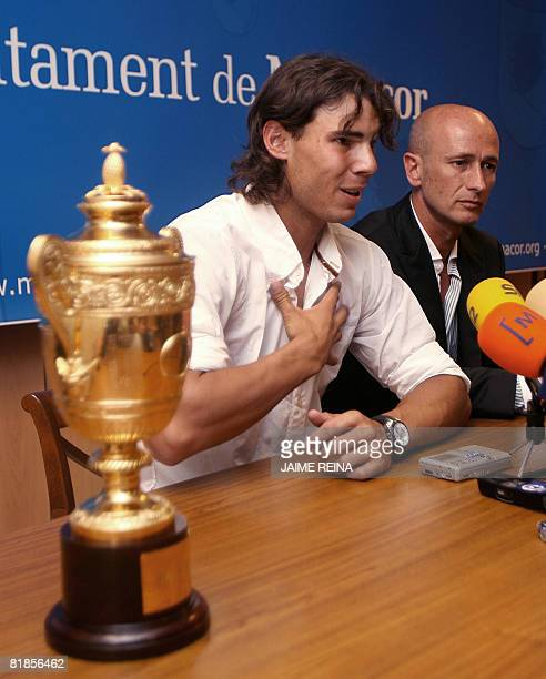 Spain's Rafael Nadal answers media questions in front of his Wimbledon trophy at the Manacor's town hall, Mallorca, Balearics Islands on July 08,...