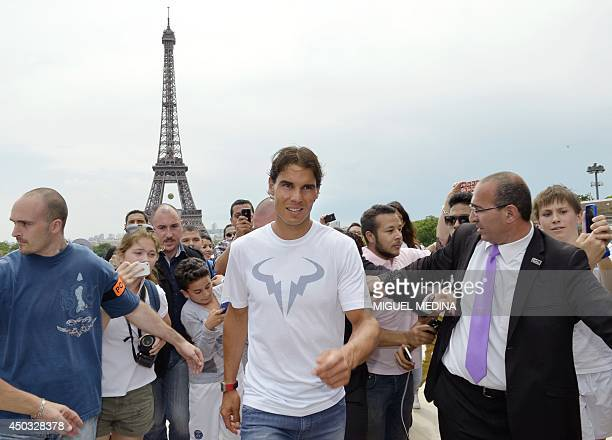 Spain's Rafael Nadal arrives for a photocall on June 9 2014 in Paris a day after winning the French tennis Open men's final match at the Roland...
