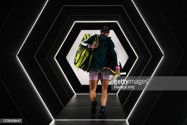Spain's Rafael Nadal arrives on the court for his men's singles second round tennis match against Spain's Feliciano Lopez on day 3 at the ATP World...