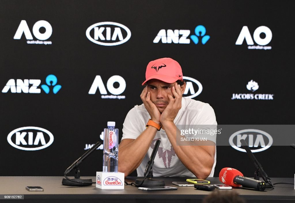 TOPSHOT - Spain's Rafael Nadal attends a press conference after retiring against Croatia's Marin Cilic in their men's singles quarter-finals match on day nine of the Australian Open tennis tournament in Melbourne on January 23, 2018. /
