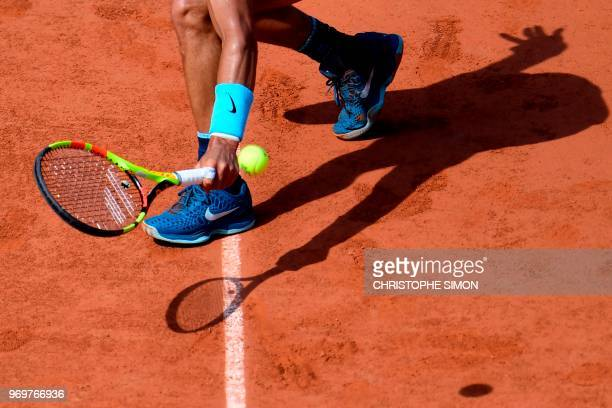 Spain's Rafael Nadal casts a shadow on court as he plays a backhand return to Argentina's Juan Martin del Potro during their men's singles semi-final...
