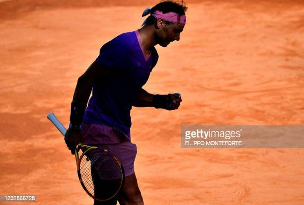 Spain's Rafael Nadal celebrates a point against Canada's Denis Shapovalov during their match of the Men's Italian Open at Foro Italico on May 13,...