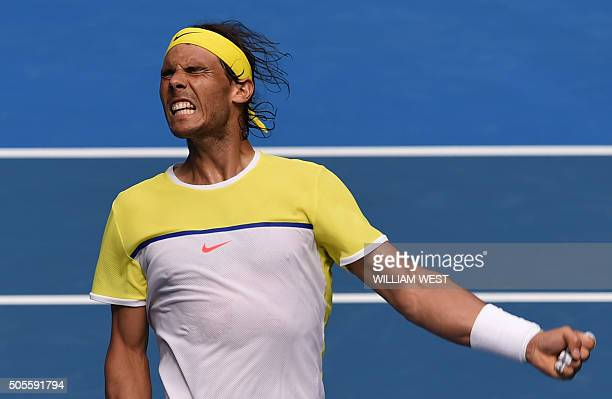 TOPSHOT Spain's Rafael Nadal celebrates a point during his men's singles match against compatriot Fernando Verdasco on day two of the 2016 Australian...