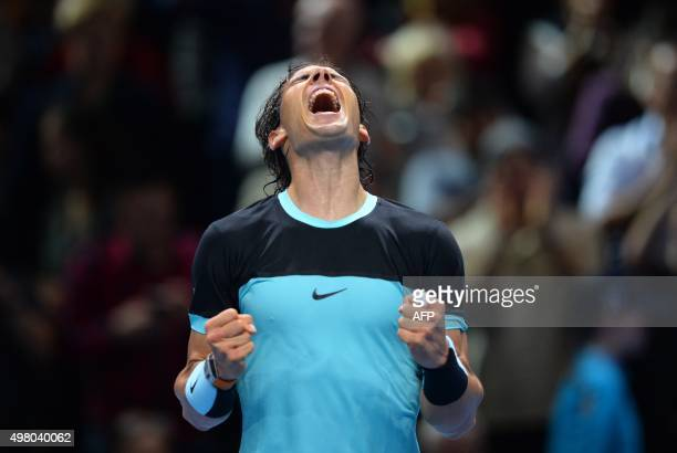 Spain's Rafael Nadal celebrates after beating Spain's David Ferrer during a men's singles group stage match on day six of the ATP World Tour Finals...