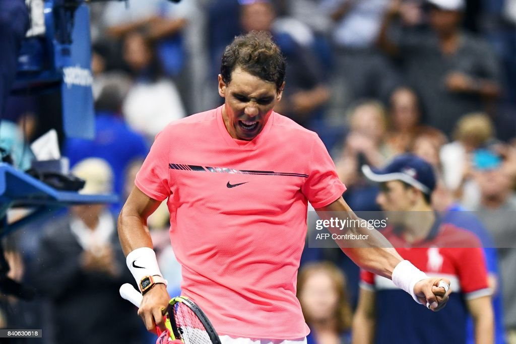 TOPSHOT - Spain's Rafael Nadal celebrates after defeating Serbia's Dusan Lajovic during their 2017 US Open Men's Singles match at the USTA Billie Jean King National Tennis Center in New York on August 29, 2017. PHOTO / Jewel SAMAD