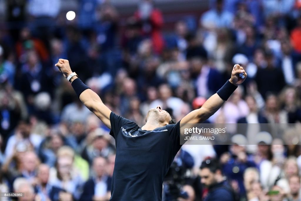 Spain's Rafael Nadal celebrates after defeating South Africa's Kevin Anderson during their 2017 US Open Men's Singles final match at the USTA Billie Jean King National Tennis Center in New York on September 10, 2017. Rafael Nadal raced to a third US Open title and 16th Grand Slam crown on Sunday with a 6-3, 6-3, 6-4 rout of South African giant Kevin Anderson. / AFP PHOTO / Jewel SAMAD
