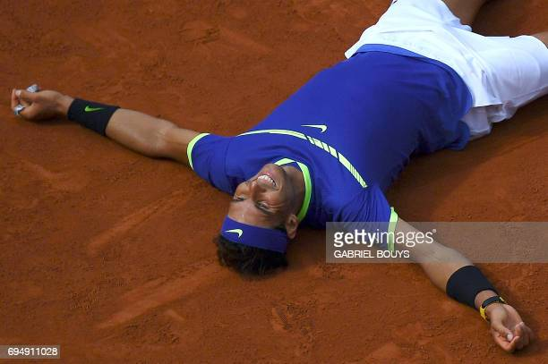 Spain's Rafael Nadal celebrates after defeating Switzerland's Stanislas Wawrinka during the men's final tennis match at the Roland Garros 2017 French...