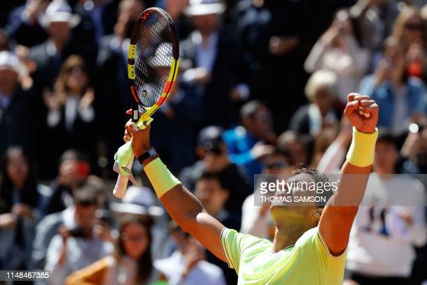 Spain's Rafael Nadal celebrates after winning against Switzerland's Roger Federer during their men's singles semifinal match on day 13 of The Roland...