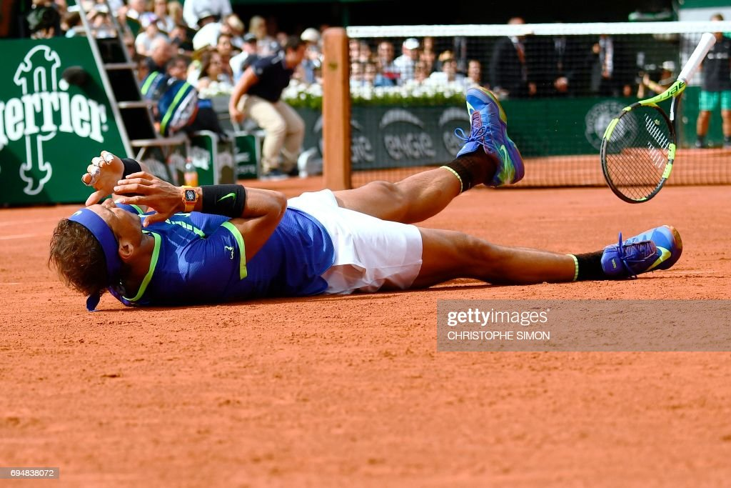 Spain's Rafael Nadal celebrates after winning the men's final tennis match against Switzerland's Stanislas Wawrinka at the Roland Garros 2017 French Open on June 11, 2017 in Paris. /