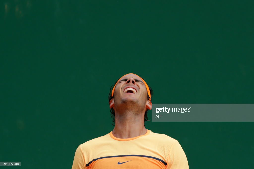 Spain's Rafael Nadal celebrates after winning the Monte-Carlo ATP Masters Series Tournament final match, on April 17, 2016 in Monaco. Nadal defeated Monfils 7-5, 5-7, 6-0 to win a record ninth title at the Monte Carlo Masters.