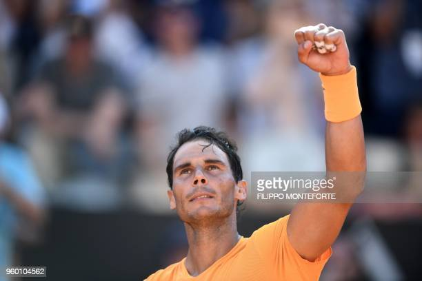 TOPSHOT Spain's Rafael Nadal celebrates after winning the semi final match against Serbia's Novak Djokovic at Rome's ATP Tennis Open tournament at...