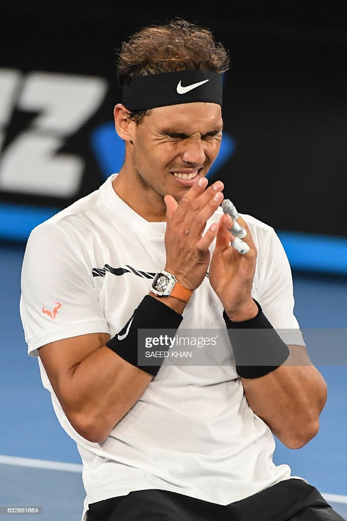 Spain's Rafael Nadal celebrates his victory against against Canada's Milos Raonic during their men's singles quarter-final match on day ten of the Australian Open tennis tournament in Melbourne on January 25, 2017. / AFP / SAEED