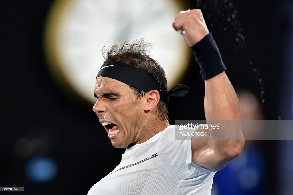 TOPSHOT - Spain's Rafael Nadal celebrates his victory against Cyprus's Marcos Baghdatis during their men's singles second round match on day four of the Australian Open tennis tournament in Melbourne on January 20, 2017. / AFP / PAUL