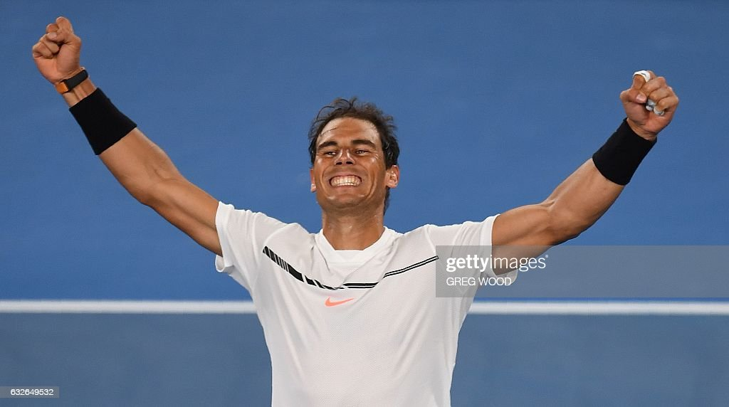 TOPSHOT - Spain's Rafael Nadal celebrates his win against Canada's Milos Raonic during their men's singles quarter-final match on day ten of the Australian Open tennis tournament in Melbourne on January 25, 2017. / AFP / GREG