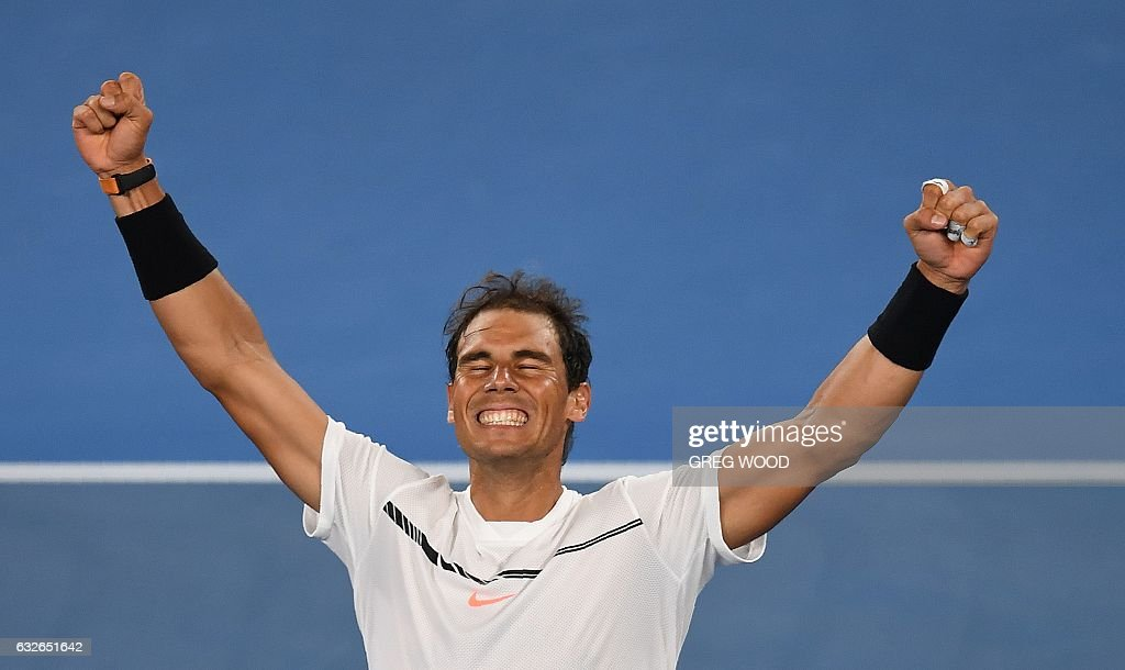 Spain's Rafael Nadal celebrates his win against Canada's Milos Raonic during their men's singles quarter-final match on day ten of the Australian Open tennis tournament in Melbourne on January 25, 2017. / AFP / GREG