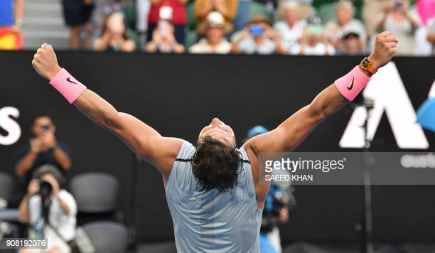 TOPSHOT Spain's Rafael Nadal celebrates victory against Argentina's Diego Schwartzman during their men's singles fourth round match on day seven of...