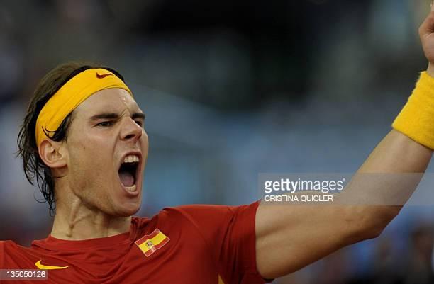 Spain's Rafael Nadal celebrates winning the Davis Cup final fourth match against Argentina's Juan Martin Del Potro at La Cartuja Olympic stadium in...