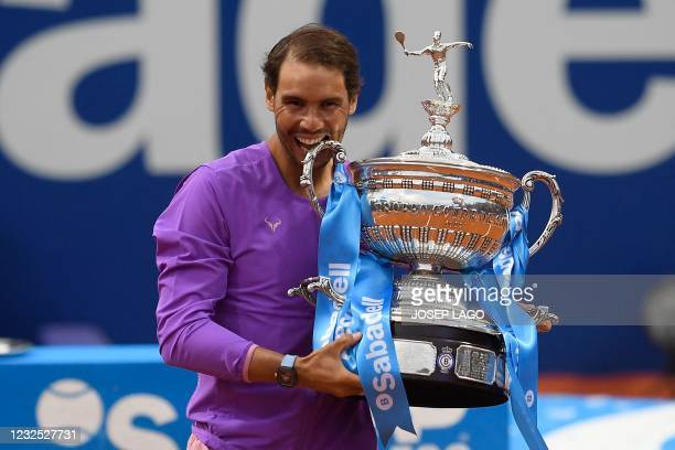 Spain's Rafael Nadal celebrates with the trophy after winning the ATP Barcelona Open tennis tournament singles final match against Greece's Stefanos...