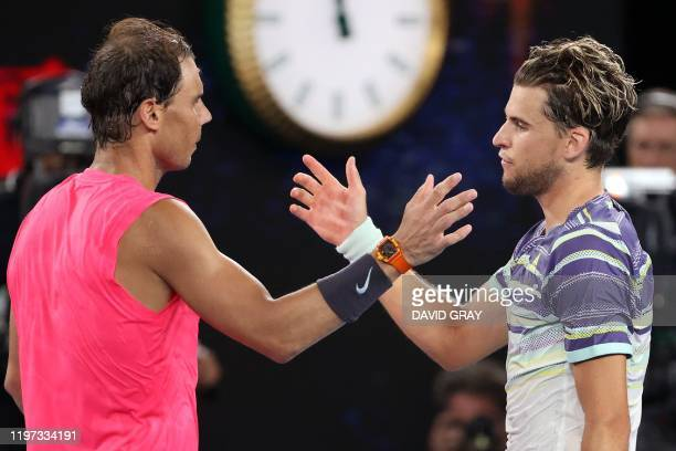 Spain's Rafael Nadal congratulates Austria's Dominic Thiem on his victory in their men's singles quarter-final match on day ten of the Australian...
