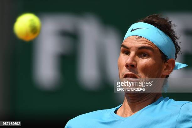 Spain's Rafael Nadal eyes the ball as he returns the ball to Germany's Maximilian Marterer during their men's singles fourth round match on day nine...