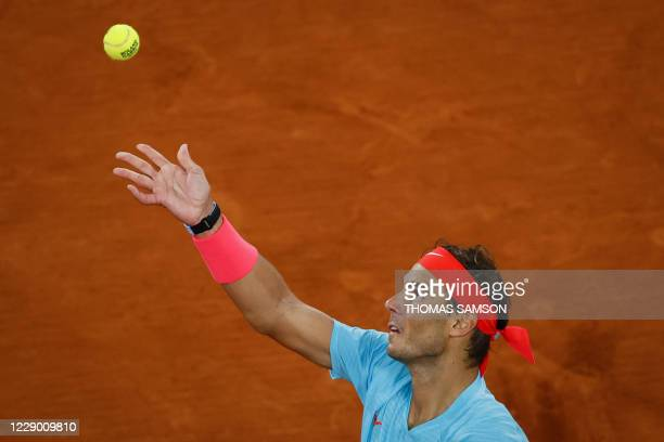 Spain's Rafael Nadal eyes the ball as he serves to Serbia's Novak Djokovic during their men's final tennis match at the Philippe Chatrier court on...