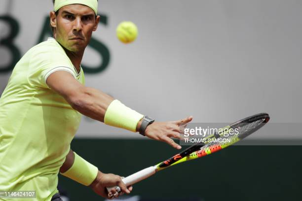 TOPSHOT Spain's Rafael Nadal eyes the ball before playing a forehand return Germany's Yannick Hanfmann during their men's singles first round match...