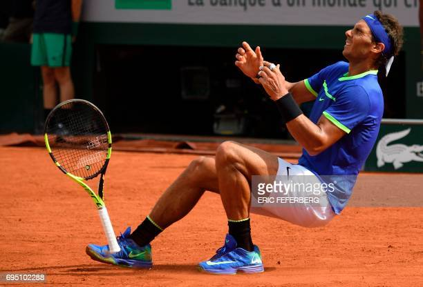 Spain's Rafael Nadal falls to the court as he celebrates after winning the men's final tennis match against Switzerland's Stanislas Wawrinka at the...
