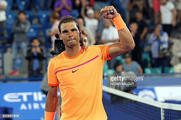 Spain's Rafael Nadal gestures after defeating Canada's Milos Raonic during their semifinal match in the Mubadala World Tennis Championship in Abu...
