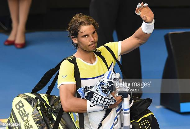 Spain's Rafael Nadal gestures as he leaves the court after defeat in his men's singles match against compatriot Fernando Verdasco on day two of the...