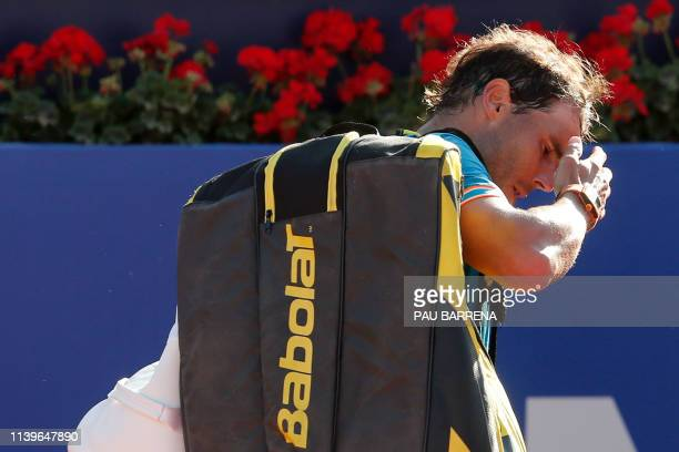 Spain's Rafael Nadal gestures as he leaves the pitch after losing the ATP Tour Barcelona Open semifinal tennis match against Austria's Dominic Thiem...