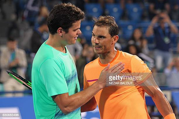 Spain's Rafael Nadal greets Canada's Milos Raonic after their semifinal match in the Mubadala World Tennis Championship in Abu Dhabi on December 30,...