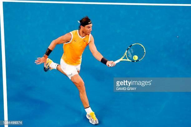 TOPSHOT Spain's Rafael Nadal hits a return against Australia's Alex de Minaur during their men's singles match on day five of the Australian Open...