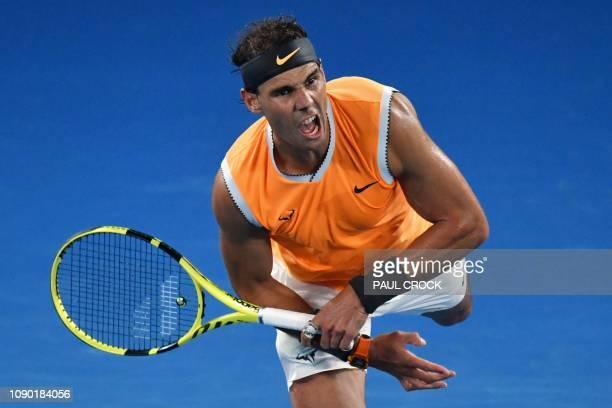Spain's Rafael Nadal hits a return against Serbia's Novak Djokovic during the men's singles final on day 14 of the Australian Open tennis tournament...