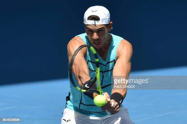 Spain's Rafael Nadal hits a return during a practice session ahead of the Australian Open tennis tournament in Melbourne on January 14 2018 / AFP...