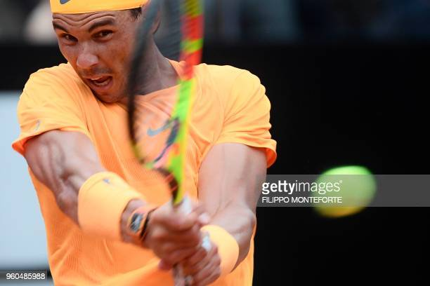 TOPSHOT Spain's Rafael Nadal hits a return during the Men's final against Germany's Alexander Zverev at Rome's ATP Tennis Open tournament at the Foro...