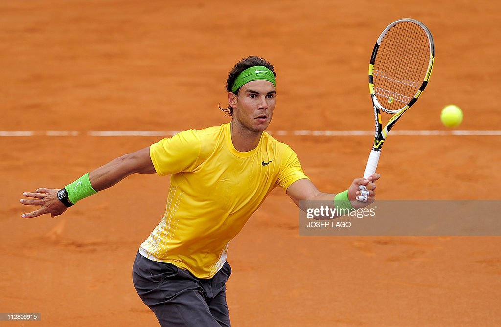 Spain's Rafael Nadal hits a return to Fr : News Photo