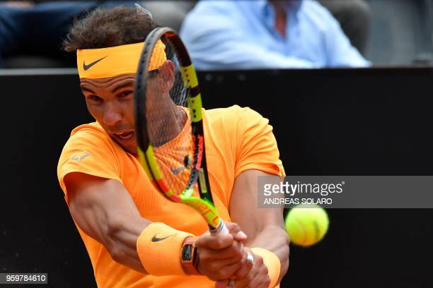TOPSHOT Spain's Rafael Nadal hits a return to Italy's Fabio Fognini during Rome's ATP Tennis Open tournament at the Foro Italico on May 18 2018 in...