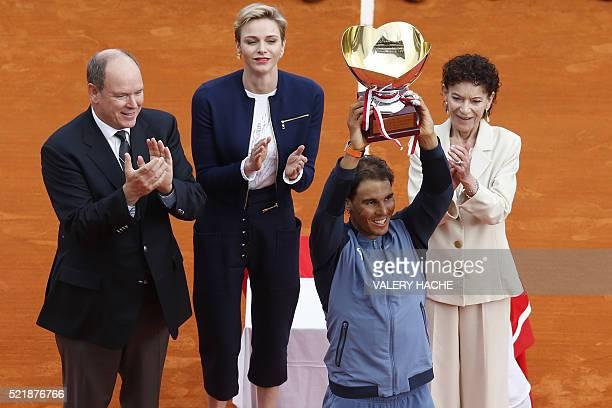 Spain's Rafael Nadal holds his trophy as Prince Albert II of Monaco Princess Charlene of Monaco and ElisabethAnne de Massy applaud during the...