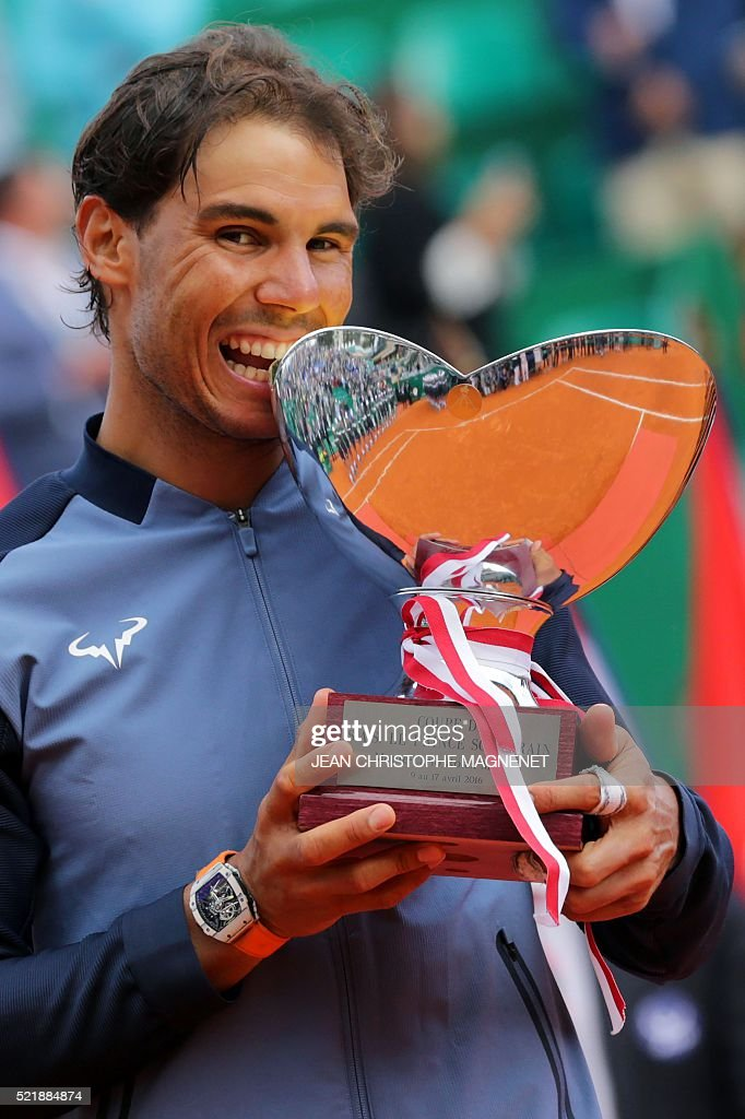 Spain's Rafael Nadal holds his trophy during the awarding ceremony following the final tennis match against France's Gael Monfils at the Monte-Carlo ATP Masters Series Tournament in Monaco on April 17, 2016. Nadal defeated Monfils 7-5, 5-7, 6-0 to win a record ninth title at the Monte Carlo Masters.