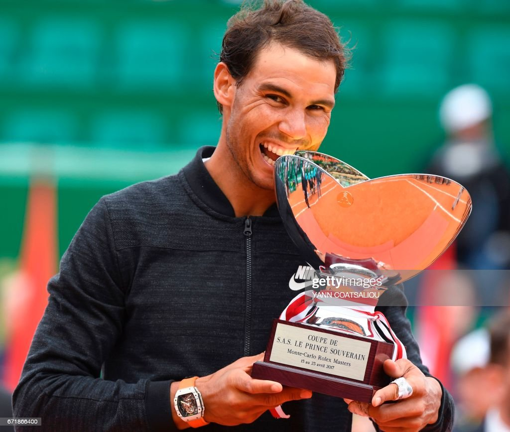 Spain's Rafael Nadal holds his trophy during the awarding ceremony following the final tennis match at the Monte-Carlo ATP Masters Series Tournament in Monaco on April 23, 2017 / AFP PHOTO / Yann COATSALIOU