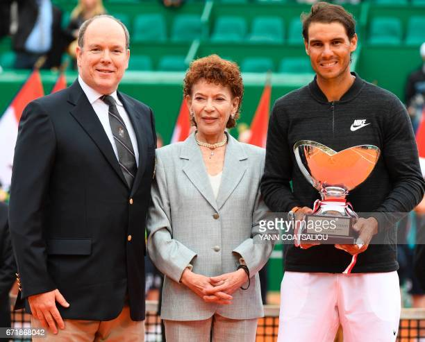 Spain's Rafael Nadal holds his trophy next to Prince Albert II of Monaco and ElisabethAnne de Massy during the awarding ceremony following the final...
